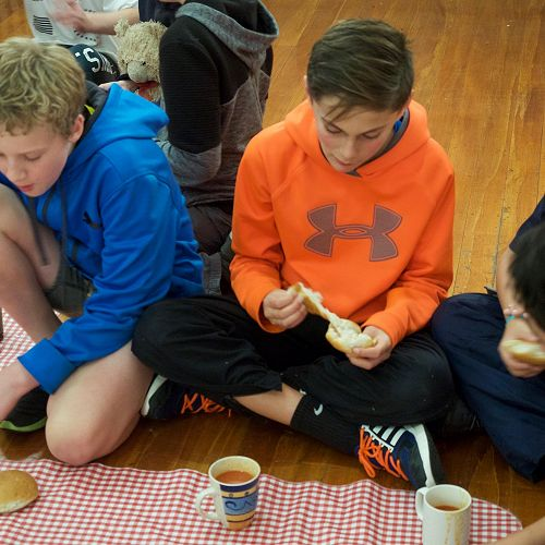Caleb, Miro and Flook sit down for their 'soup and bun' meal