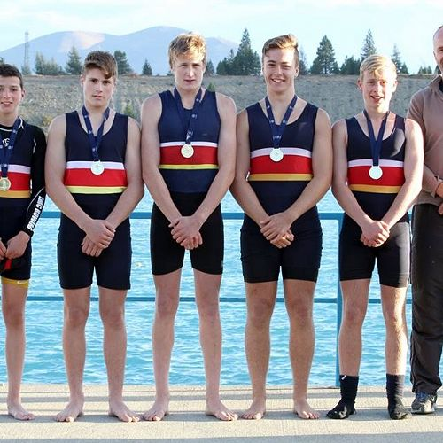 The U16 coxed quad receiving their gold medal