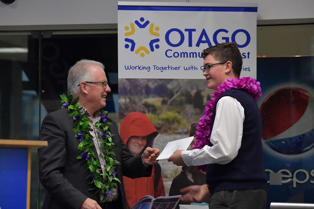 Danny Adams (Y10) receiving his Otago Polytechnic Pacific Island Recognition Award from Chris Morland.