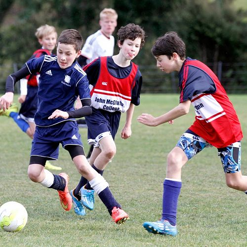 Julian Hamilton attempts to shut down the player in the Waihi Exchange Football Game.