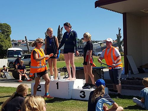 Caitlin O'Brien receives her 1st place medal. Phoebe Ozanne looks on in 2nd place.