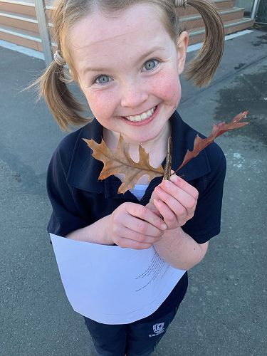 Eleanor Sammes shows the autumn leaf she has found.  It is something that makes her happy!