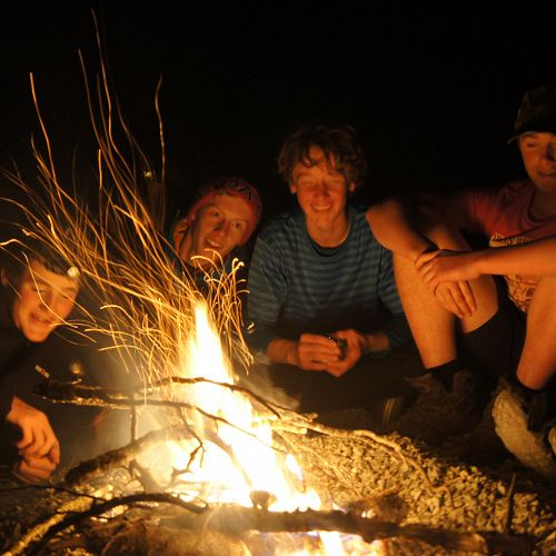 Nic, Riley, Sam and Jack relaxing by the campfire