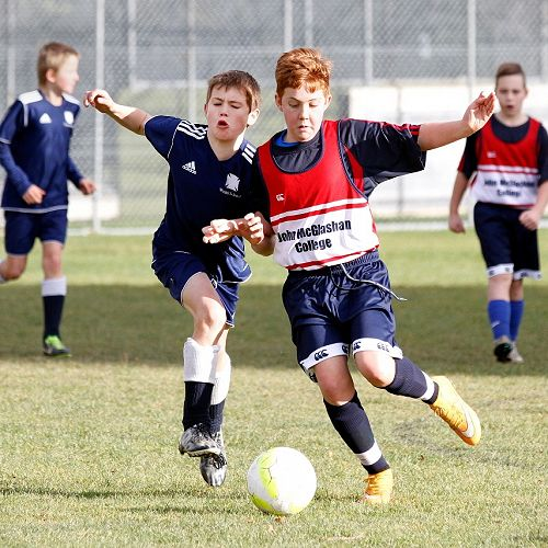 Reuben Cook wins the ball in a centre-mid-field battle in the Waihi Exchange Football Game