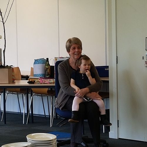 Jill with her grandaughter listening to the waiata sung by the staff