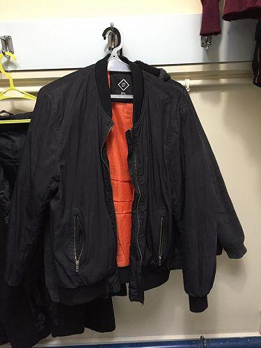 Black jacket, orange lining