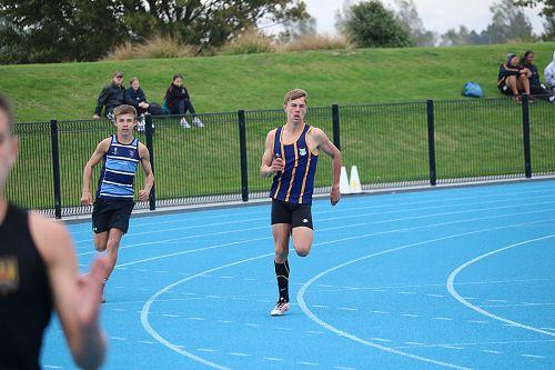 Harrison Laing winning the Under 14 400m