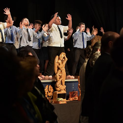 Eyes on the Prize: The Te Paepae Kaka Trophy in the foreground as students from Riccarton High School and St Thomas' College perform their haka