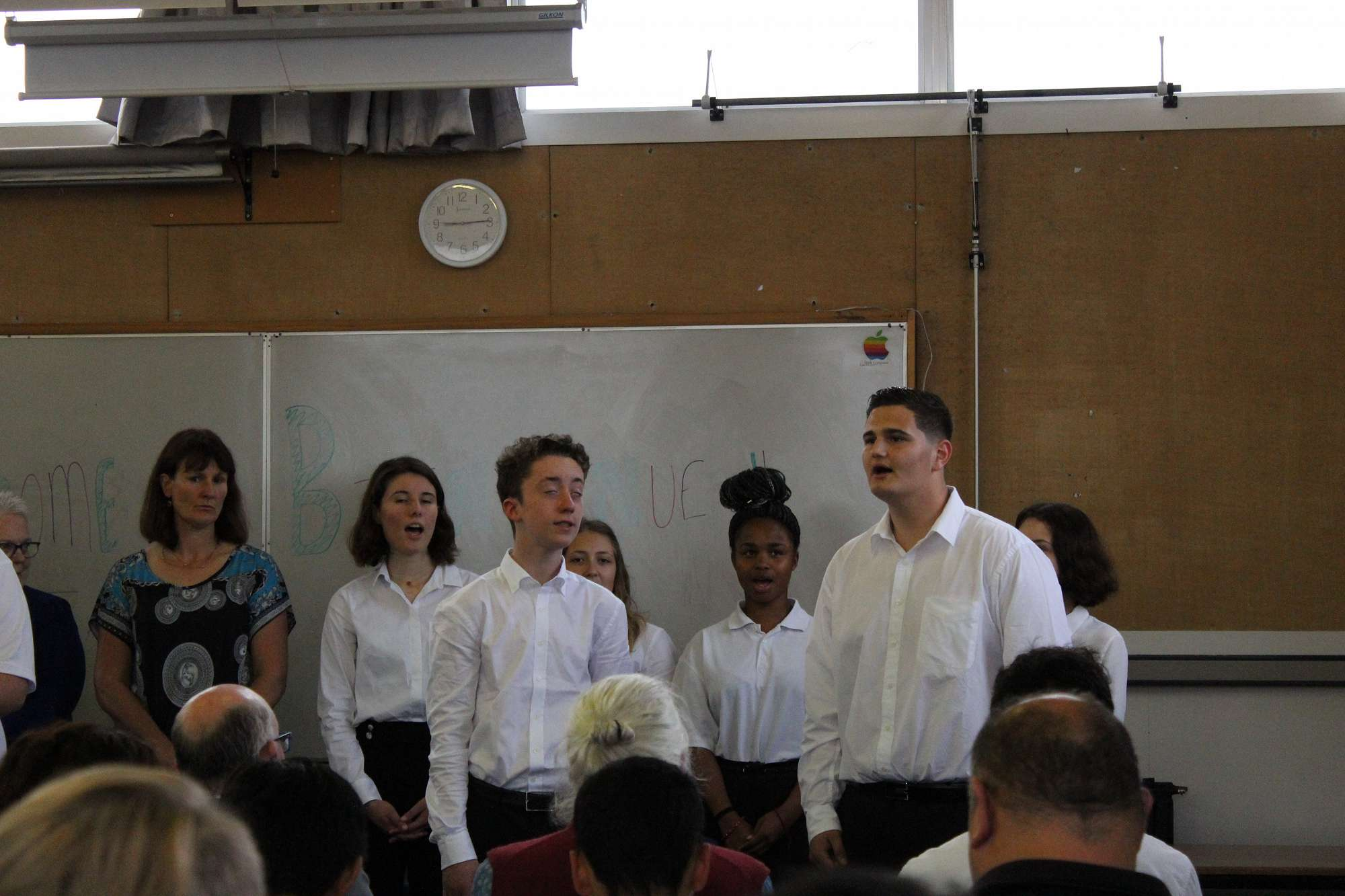 The French students perform waiata during the powhiri
