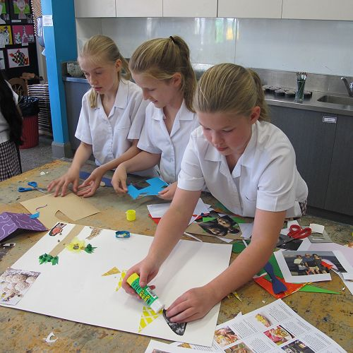 Poppy, Caitlyn and Alice working on their poster.