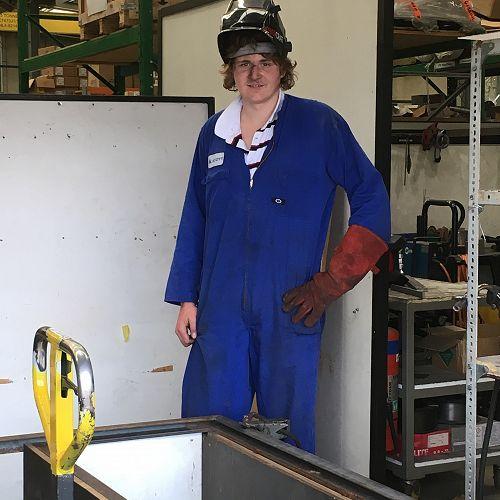 Harry Russell takes a break from welding on Gateway