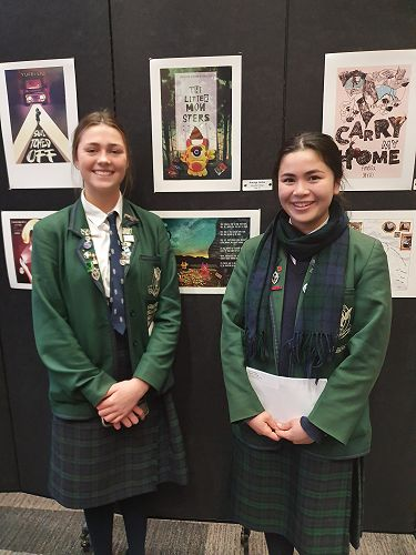 Our Scholarship winners Amaya Leslie and Amelia Chang next to their winning Designs.