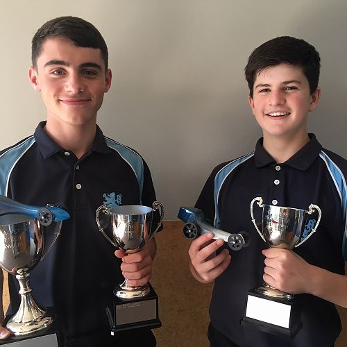 From left; Oli Phillips and William McCutcheon with their dragster and trophies