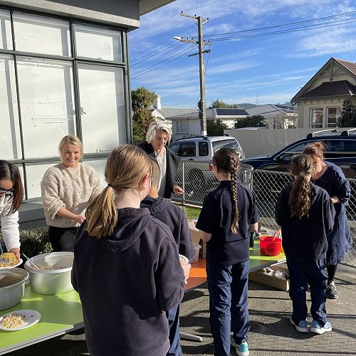 Junior School students lining up to get their delicious Chinese lunch this week