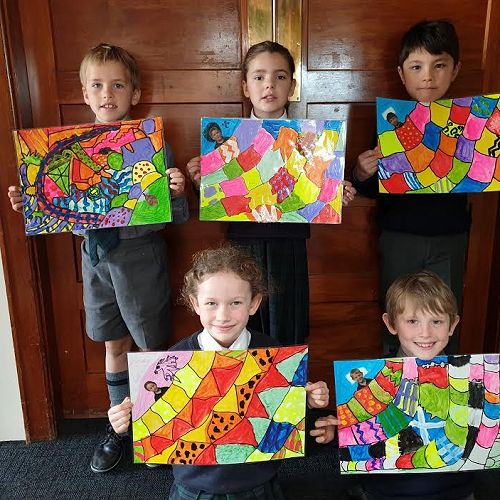Year 3 students, Jesse, Harriet, Hugh, Henry and Meabh with their quilts.