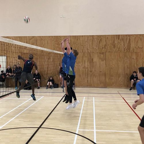 WCSS Senior Volleyball Tournament 2018 - A strong GHS wall attempting to block, Zeal Calvert #3 covers.