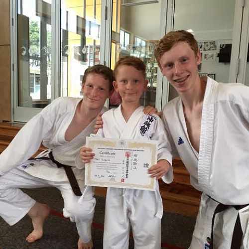 Riley and Keegan Hall celebrate the karate success of one of their primary school students