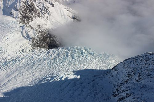 Flying over the Fox Glacier ice fall.