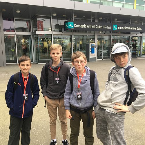 Special delivery - the year years arrive at the airport, looking surprisingly fresh faced after four days at camp.