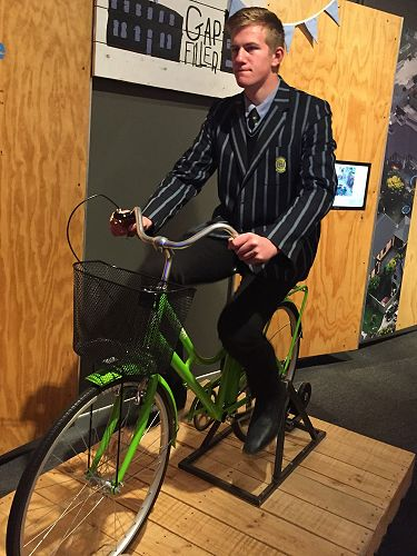Cameron McConchie uses pedal power to watch a clip about pedal power