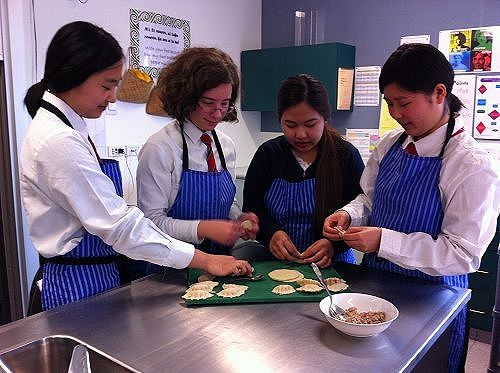 This dumpling making class is being taken by some of our international students.