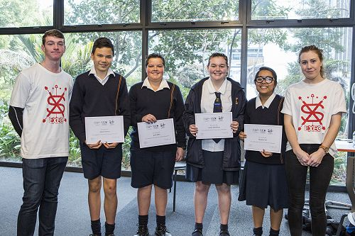 Adam Stedman, Jacob Miles, Jordyn Hasselberg, and Muskaan Lal receive their UC Student Volunteer Army UCan programme completion certificates from the Student Volunteer Army's In-schools team of Daniel Stack and Bonnie Dalton.