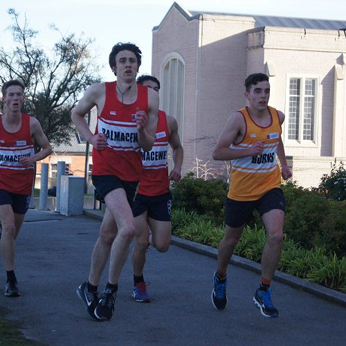 The lead group of the tightly-contested senior cross country
