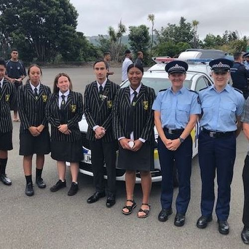 Mr Chapman with a group of students and                    Police recruits