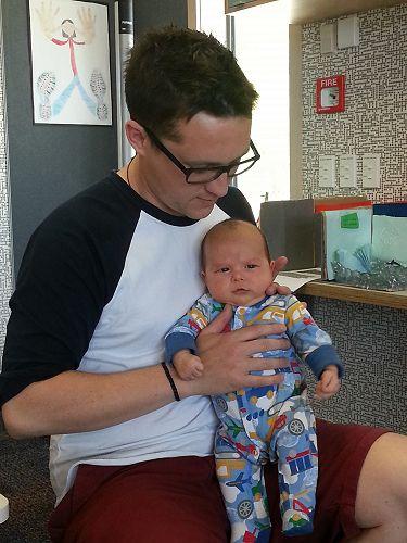 Matt and his newborn son, Charlie.