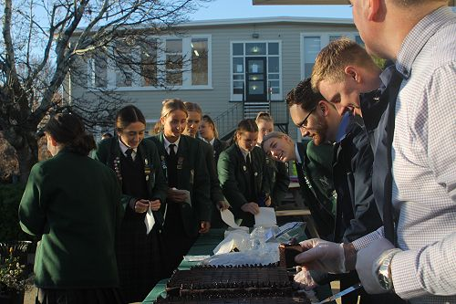 Students lining up for cake