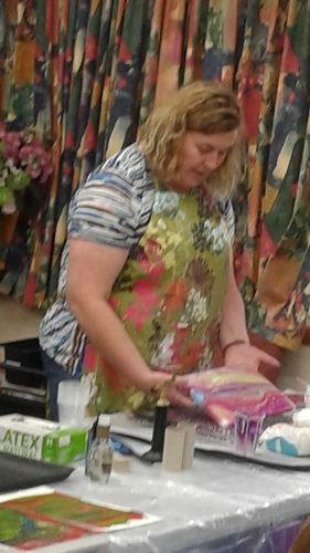 Debbie Foster demonstrating paint pouring