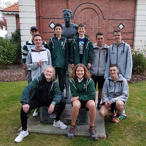 National Cross Country Team Members pictured with the statue of Jack Lovelock outside Timaru Boys High School.