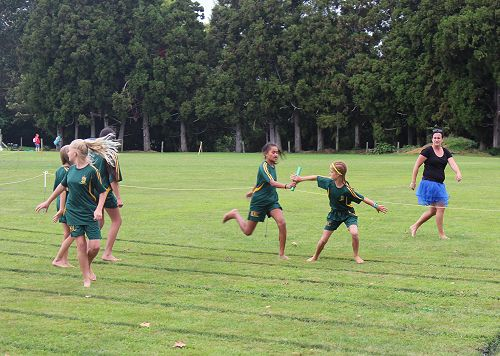 Deizyl Toma hands over the baton to Mackenzie Walter for Year 7 Girls MacMillan in the 4 x 100m relay