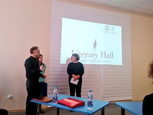 David Howard receives a presentation at the openin