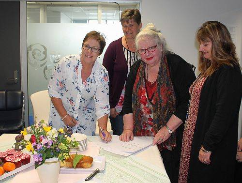 Lysette Riley from CYF signs MoU