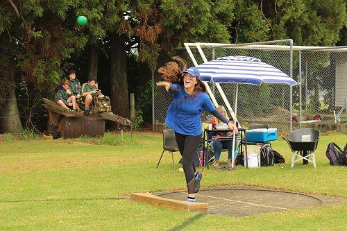 Stewart House Captain Libby Drake throwing the shotput for Senior Girls