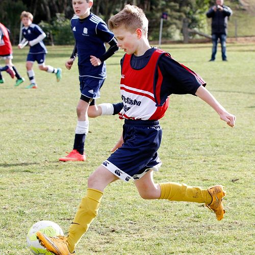 Grayson Westgate clears the ball up-field in the Waihi Exchange Football Game.