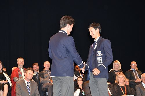 Eddie Grant congratulating Max Chu who will take o