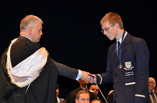 Richard Hall awarding Sam Belcher with Dux for 201