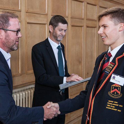 Board chair, Tim Hannagan, congratulates Jack Grey