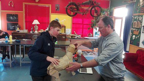 Mr Jones helps with year 10 sculpture