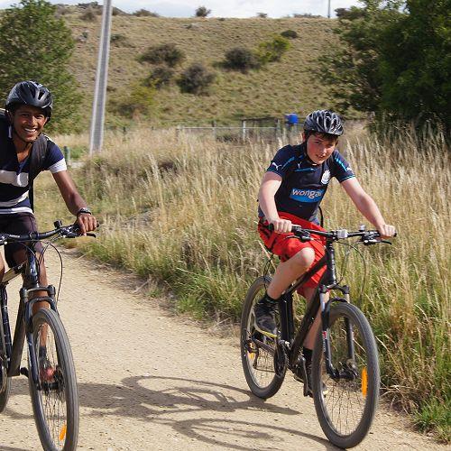 Krishan and Luka ride towards Kokonga