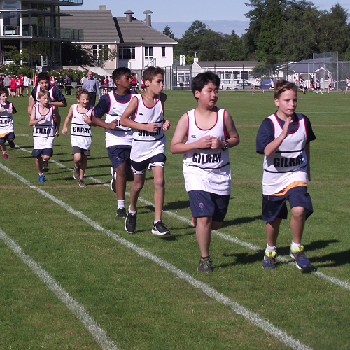 Junior members of Gilray house compete in the 400m trials