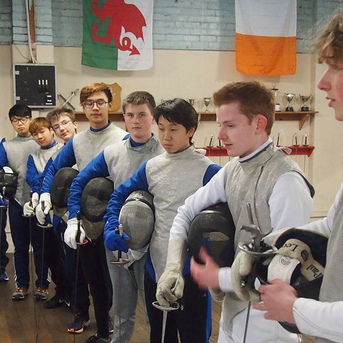The McGlashan fencers suited up with weapons, masks and lamés.