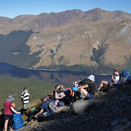 The group pauses for a break during the climb to the saddle