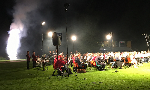 """An open-air concert culminated in combined bands playing """"Music for Royal Fireworks"""" by Handel; accompanied by a spectacular fireworks display."""