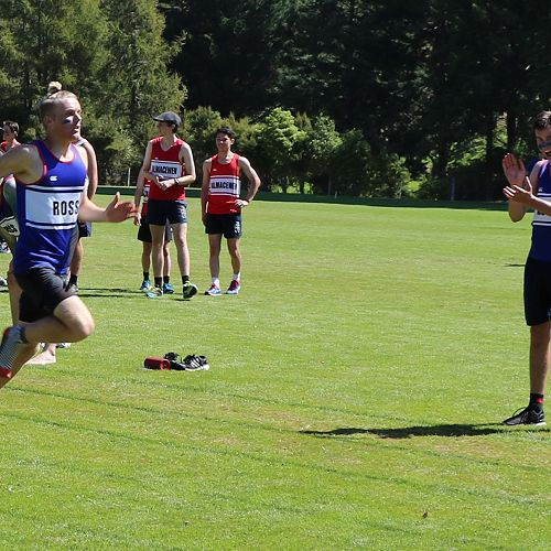 Taylor Mechen carries Ross Home with a decisive lead in the Senior Relay cheered on by Jordan Gain.