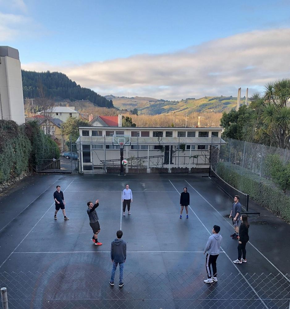 Volleyball warm-up on the College's tennis court