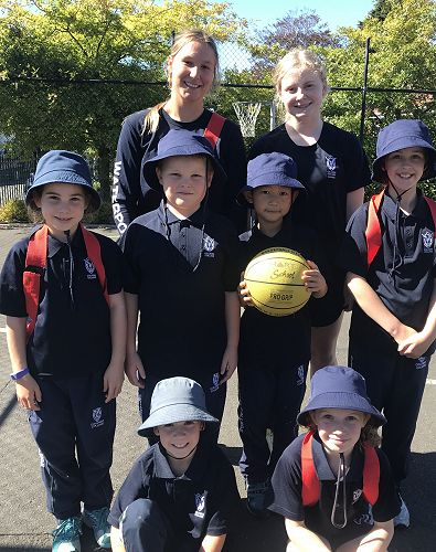 Emily Peacock and Paige O'Brien with their group of Miniball students.