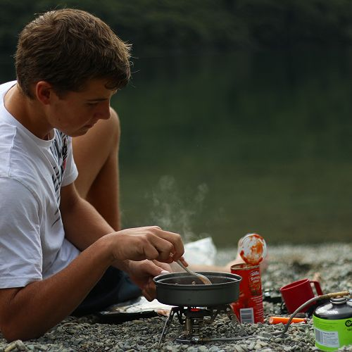 Angus Simmers cooks dinner beside the North Lake.